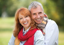 Photo of a man and woman smiling. Link to Life Stage Gift Planner Ages 60-70 Situations.