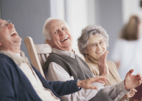 Photo of two men and a woman laughing. Link to Life Stage Gift Planner Over Age 70 Situations.